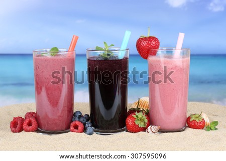Smoothies fruit juice with fruits smoothie in summer on the beach - stock photo