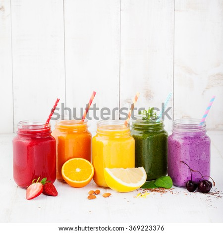 Smoothies, juices, beverages, drinks variety with fresh fruits and berries on a white wooden background Copy space - stock photo