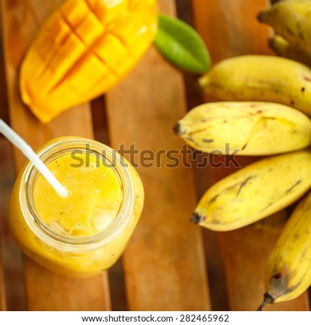 Smoothies mango and banana in a glass jar - stock photo