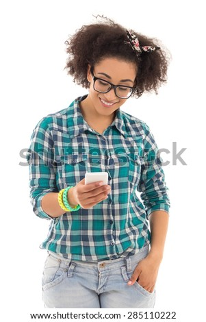 sms concept - beautiful african american teenage girl with mobile phone isolated on white background - stock photo