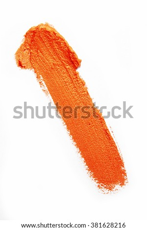 smudge orange creamy eyeshadow on white background - stock photo