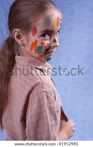 Smudged little painter. looking behind - stock photo