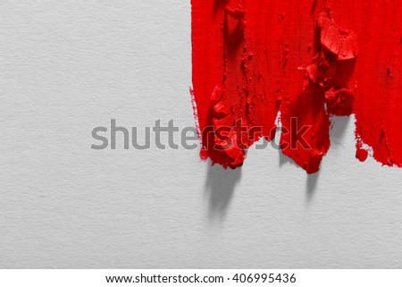 Smudged red lipstick on white background, close up - stock photo