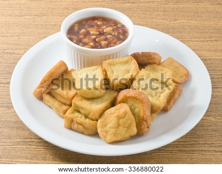 Snack and Dessert, Chinese Deep Fried Tofu or Fried Bean Curd Served with Sweet and Sour Spicy Sauce.  - stock photo