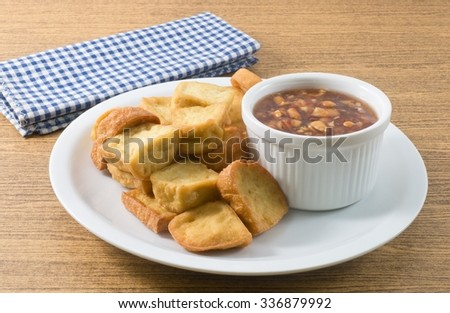 Snack and Dessert, Dish of Chinese Traditional Deep Fried Tofu or Fried Bean Curd Served with Sweet and Sour Spicy Sauce. - stock photo