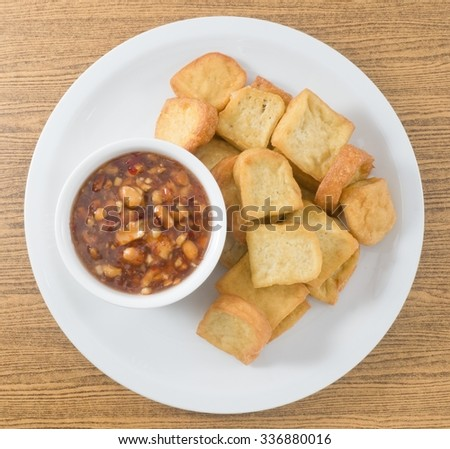 Snack and Dessert, Top View of Chinese Deep Fried Tofu or Fried Bean Curd Served with Sweet and Sour Spicy Sauce. - stock photo