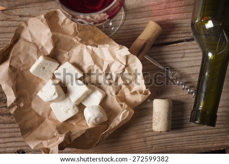 snack and wine on a wooden table - stock photo