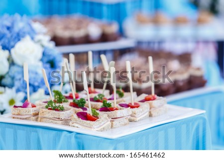 snack bar in cocktail party, sandwiches with sticks ready to serve - stock photo