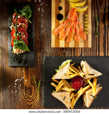 Snack Set - Club Sandwich, Caprese Salad and Cured Salmon - stock photo