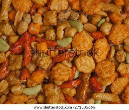 Snacks background with salty crunchy treats, Japanese Otsumami rice cracker  snack chip and peanut - stock photo