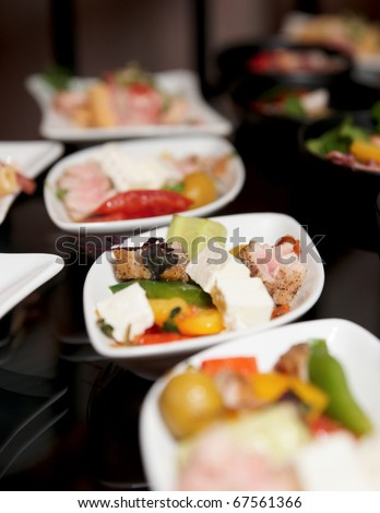 Snacks on banquet table - stock photo