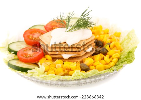 Snacks with vegetables, crackers and cheese cream on plate. - stock photo