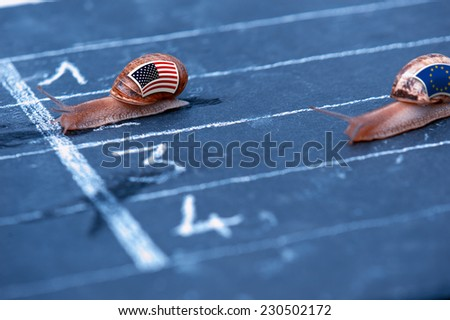 snails race metaphor about Usa against Europe - stock photo