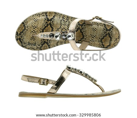 snake leather sandal decorated with gems on white