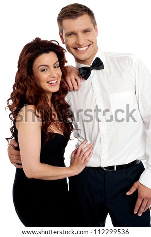 Snapshot of cheerful attractive couple embracing each other - stock photo