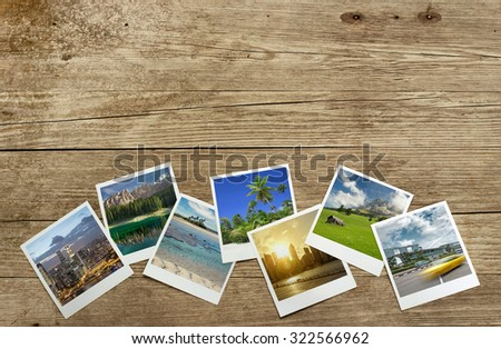 snapshots of travel destinations on wooden background - stock photo