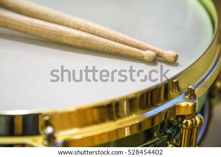 Snare drum and drumsticks before a concert in a orchestra on stage