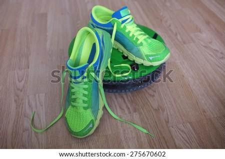 Sneaker or trainer on wood floor  - stock photo