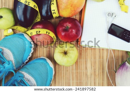 sneakers, centimeter, red apples, weight loss, running, healthy eating, healthy lifestyle concep - stock photo