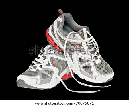 Sneakers isolated on black background - stock photo