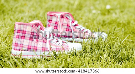 Sneakers on the grass - stock photo