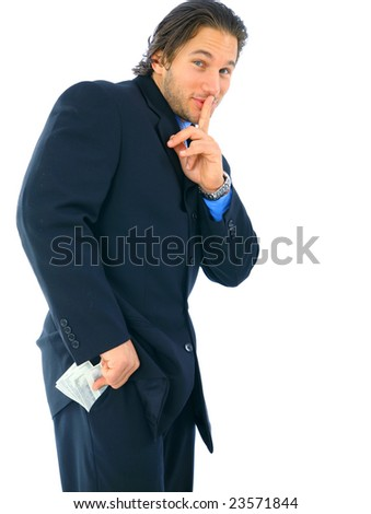 sneaky young caucasian businessman hiding money on his pocket. concept for corruption