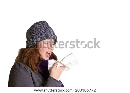 Sneezing woman with handkerchief in warm clothes, isolated, copy space - stock photo