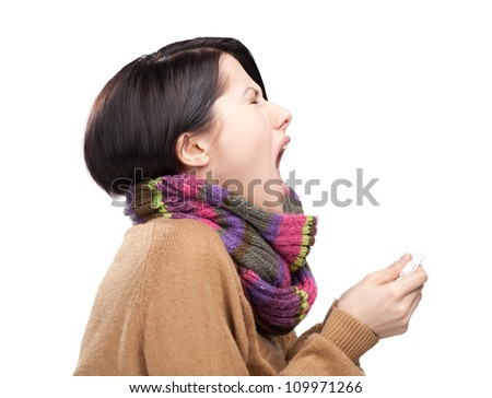Sneezing young attractive woman holding wipe in her hands, isolated - stock photo