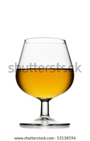 Snifter glass of brandy isolated over white background - stock photo