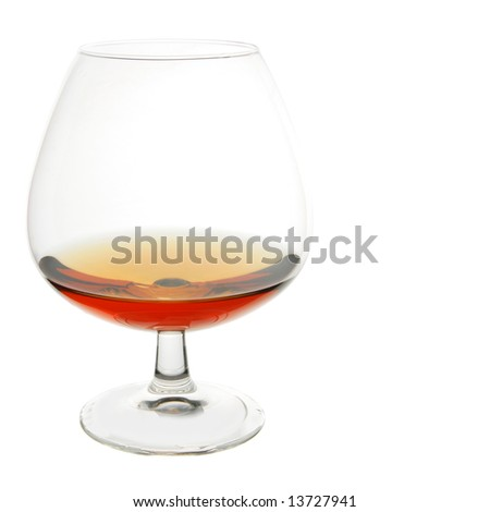 Snifter glass of cognac isolated over white background - stock photo