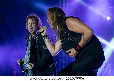 SNINA, SLOVAKIA - AUGUST 8: Ronnie Atkins and Tobias Sammet perform with Avantasia project on music festival Rock pod Kamenom in Snina, Slovakia on August 8, 2013 - stock photo