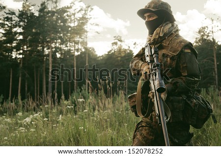 Sniper change position. Preparations for the attack. - stock photo