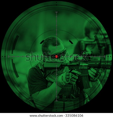 sniper during night mission/operation hostage rescue.view through the night vision scope