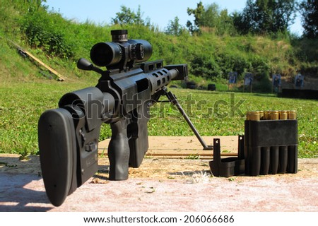 Sniper rifle .50 BMG caliber on shooting range. - stock photo