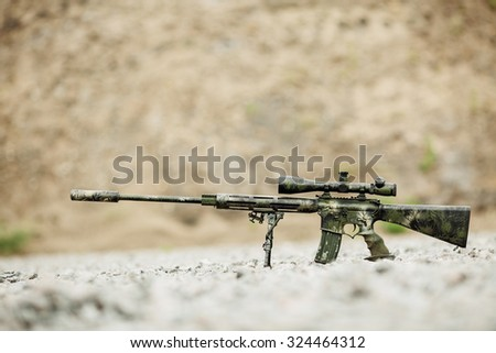Sniper rifle on bipod  on nature background - stock photo