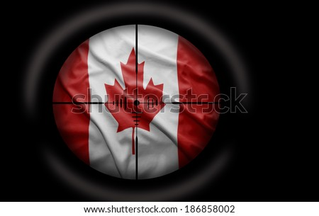Sniper scope aimed at the Canadian flag - stock photo