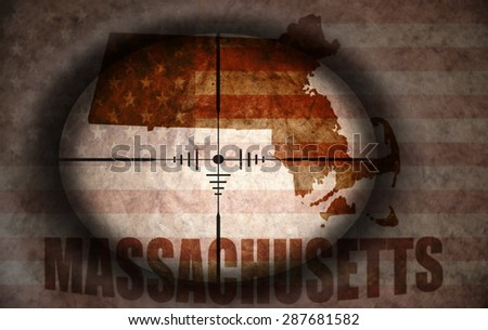 sniper scope aimed at the vintage american flag and massachusetts state map - stock photo