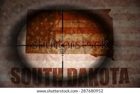 sniper scope aimed at the vintage american flag and south dakota state map - stock photo
