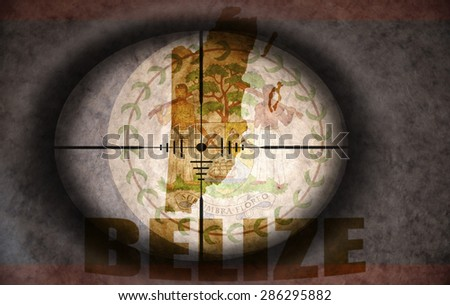 sniper scope aimed at the vintage belize flag and map - stock photo