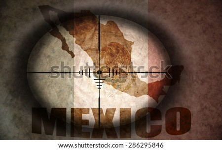 sniper scope aimed at the vintage mexican flag and map - stock photo