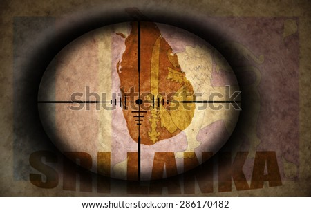 sniper scope aimed at the vintage sri lanka flag and map - stock photo