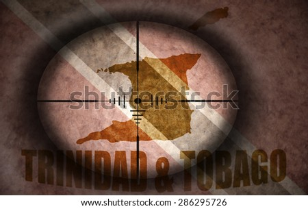 sniper scope aimed at the vintage trinidad flag and map - stock photo