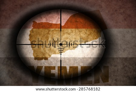 sniper scope aimed at the vintage yemeni flag and map - stock photo