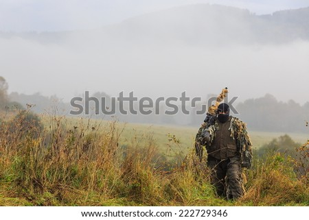 sniper with his camouflage - stock photo