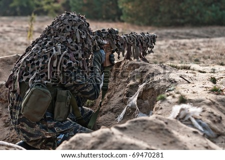 Sniper with rifle hidden in trench, stealth warrior, precise shoot - stock photo