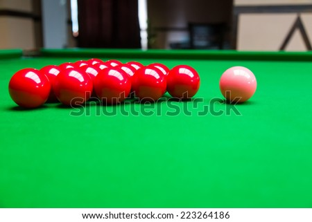 Snooker ball on snooker table.