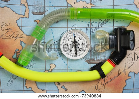 snorkel diving on the map - stock photo