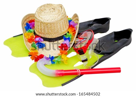 Snorkel equipment and straw hat - stock photo
