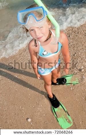 Snorkel girl - little girl on summer vacation - stock photo
