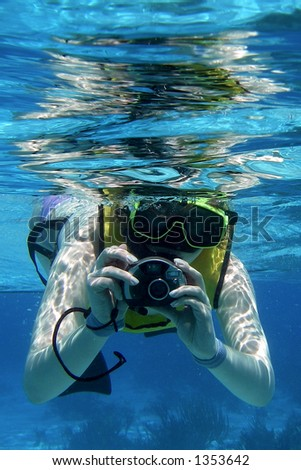 Snorkeler with Camera - stock photo